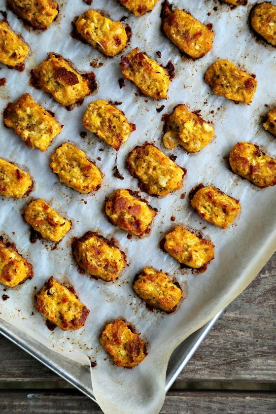 Baked, crispy, Bacon Cheddar Cauliflower Tots {Healthier Tater Tots} are the ultimate in crispy, cheesy perfection. You'd never know they're lower carb than tater tots and honestly, you'd be hard pressed to know they're NOT tater tots. Baked, crispy, Bacon Cheddar Cauliflower Tots {Healthier Tater Tots} are the ultimate in crispy, cheesy perfection. You'd never know they're lower carb than tater tots and honestly, you'd be hard pressed to know they're NOT tater tots.