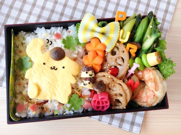Pom Pom Purin Bento  Today I made an easy character bento – Pom Pom Purin from Sanrio. Do you know Pom Pom Purin? He is a very cute golden retriever dog character that Sanrio introduced back in 1996.  http://en.bentoandco.com/blogs/news/10395593-pom-pom-purin-bento