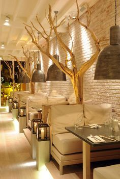 Delicious Dining Spaces: Inspiring Restaurant Interior White-washed brick walls, stunning trees, and candlelight make this Manchester restaurant Australasia both chic and relaxed for an intimate dining experience.