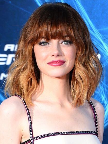 Emma StoneTwo elements of Stone's lob make it unique—and superflattering: heavy, eye-skimming bangs and barely ombré highlights. The strategy is twofold. First, the bangs: