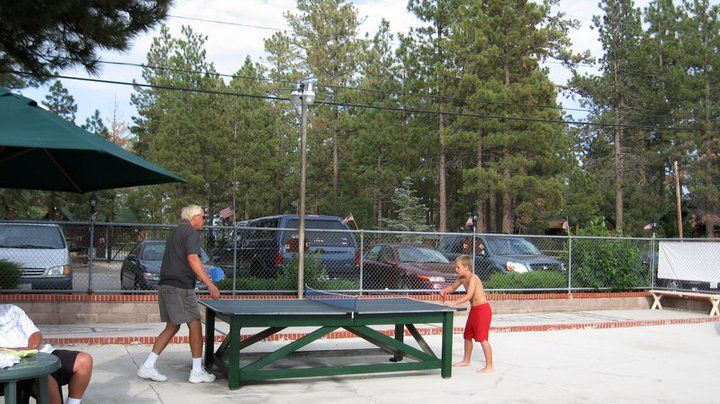 Ping pong in the pool area at Mallard Bay Resort in Big Bear Lake