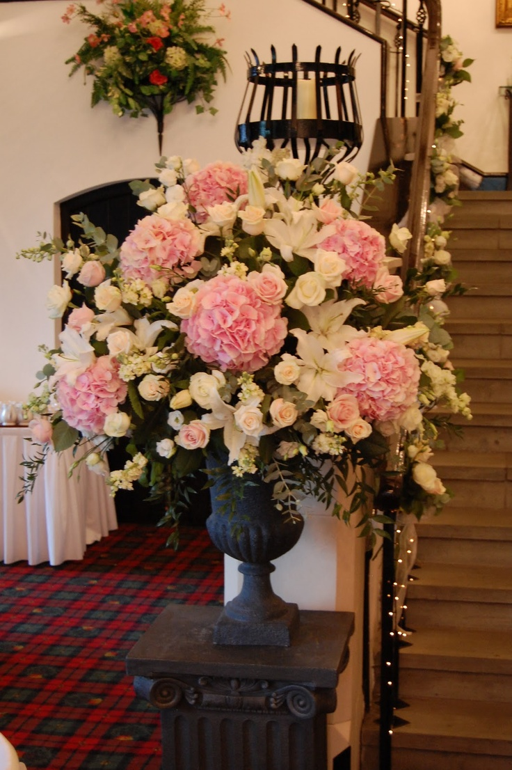 Large floral arrangement could be used at an escort table!