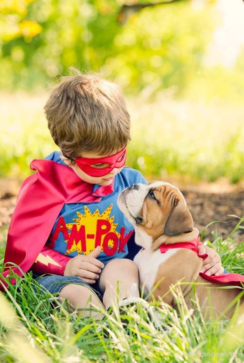 This reminds me of my son. He used to love to dress up as a super hero and play with the dog. He has always had a special connection with dogs.