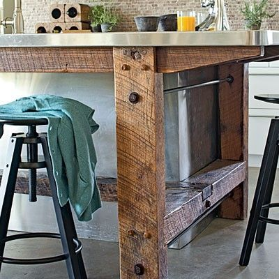 Love the contrast of the rustic wood and stainless steel top on this rustic kitchen island