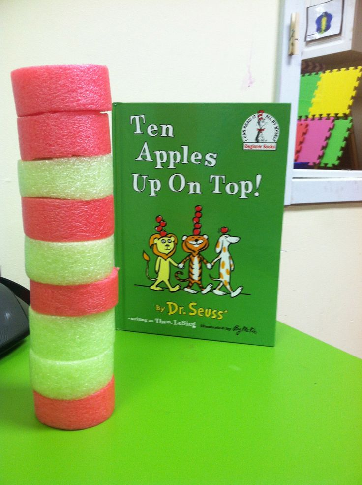 My two year old preschoolers loved stacking cut red and green pool noodles (pretending them to be apples) after reading Ten Apples Up on Top by Dr. Seuss!