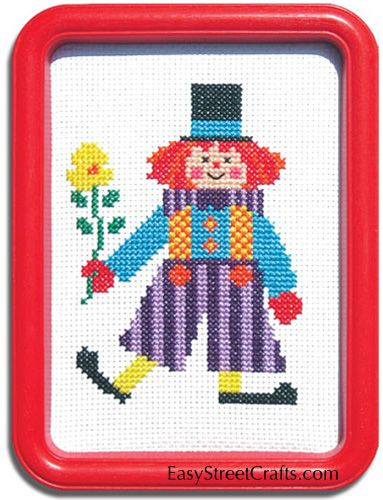 "CLOWNING AROUND --57CF -- This jazzy clown keeps the children laughing.  Kit includes a 5""x 7"" red Hoop-Frame, 11-ct Aida cloth and all materials for stitching and framing.  EasyStreetCrafts.com"