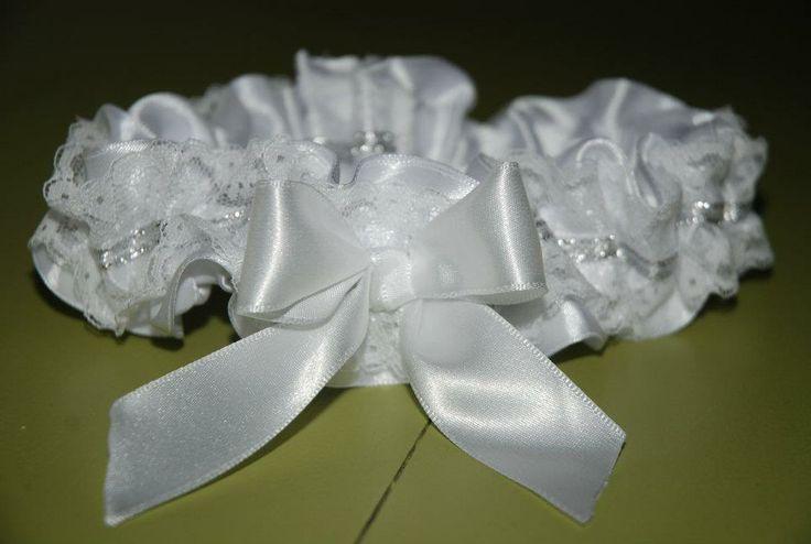 White and silver wedding garter.