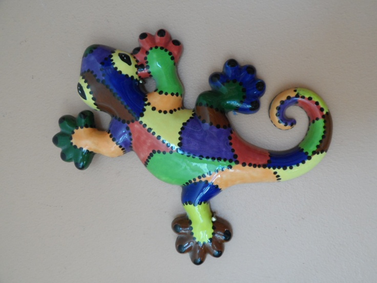 ceramic lizard painted in a patch work effect
