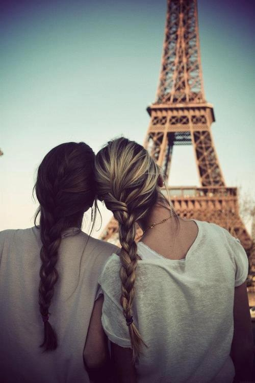 two girls looking at the eiffel tower. I want to take this with my sister when we go to Paris!