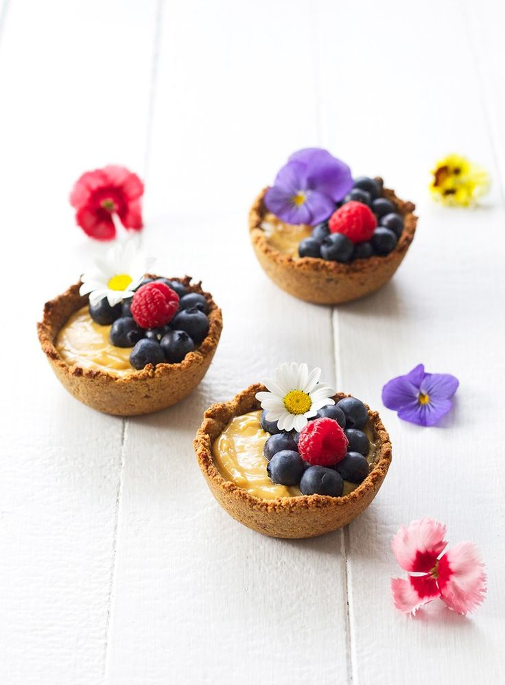 These rustic hand-pressed tarts have a gorgeous lemon flavour and a biscuit-y nut crust. The centre is rather like cheesecake, though it is spared from being too heavy because of the lovely fresh lemon flavour.