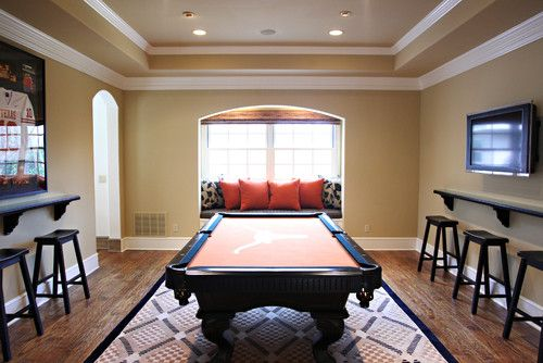 Billiard Room Design - Beautiful area rug and ceiling with clever window seating