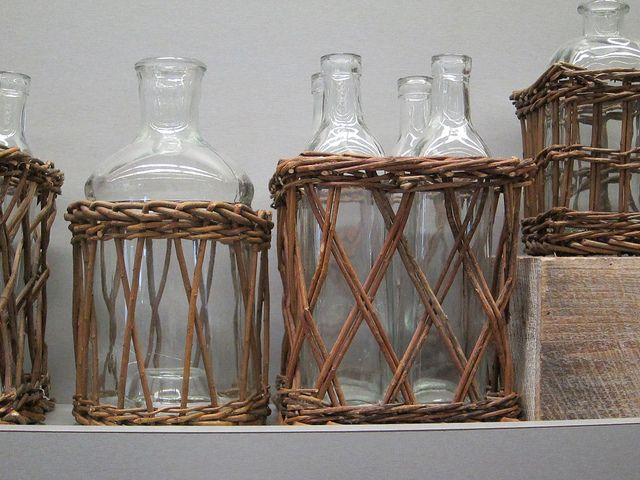 """Baskets for bottles at Brooklyn Academy of Arts cafeteria. (Isn't there another word for """"basket for bottle""""...a botsket? A bastle?)"""