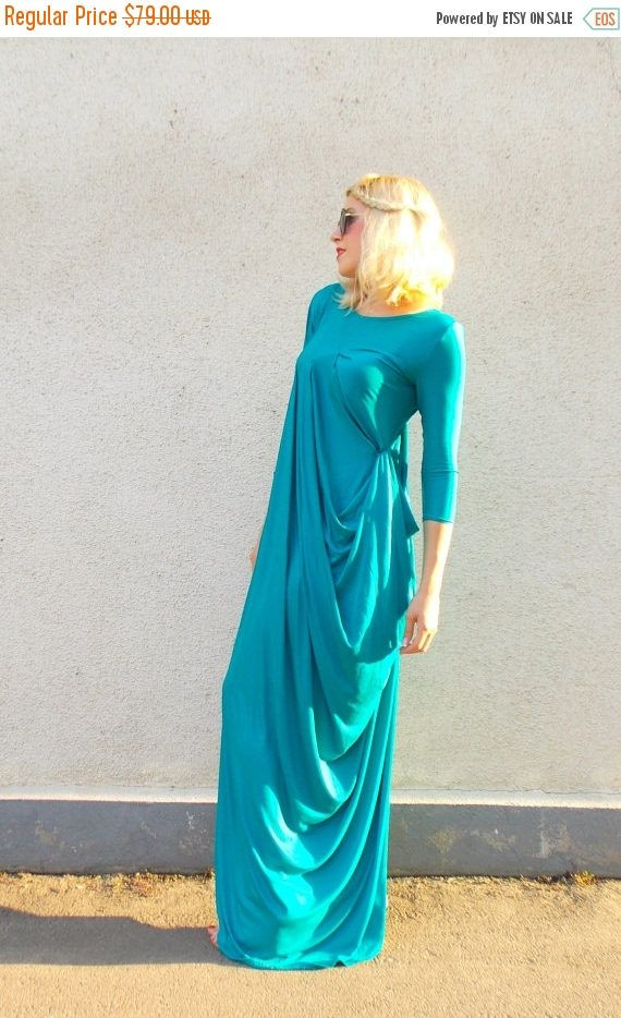 Beautiful teal kaftan with pleated shoulder. Long summer kaftan in a deep blue-green color that matches so perfectly the ocean. The extra soft fabric makes it comfortable to wear even in those rough dog days. Material: 95% viscose, 5% elastane  Care instructions: Wash at 30 degrees. The model in the picture is size S.  Can be made in ALL SIZES.  If you have any other specific requirements, do not hesitate to contact me!  I DO NOT CHARGE EXTRA MONEY for custom made items.  All you need to do…