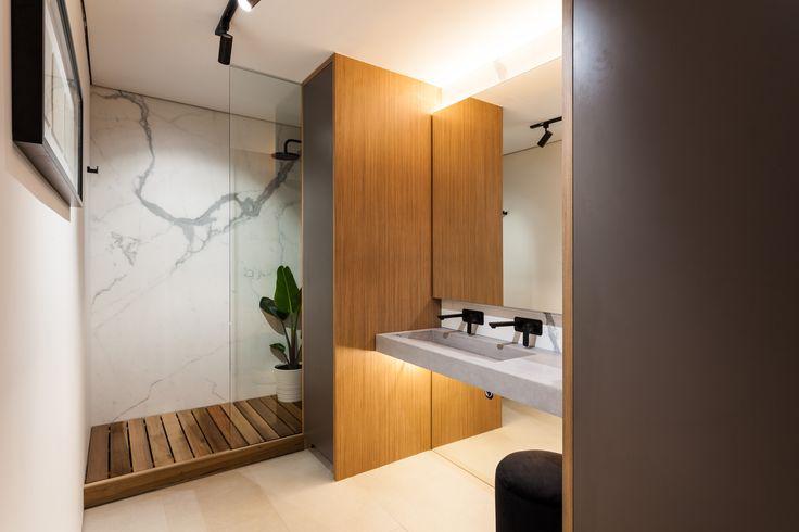 Apartment renovation - Bathroom by LDC. Claremont, Western Australia. #modernbathroom #modern #bathroom #modernapartment #smallapartment #smallapartmentideas #apartmentideas #marble #cedar #timber #concrete #mirror #floatingmirror #vanity #tracklighting #plants #shower