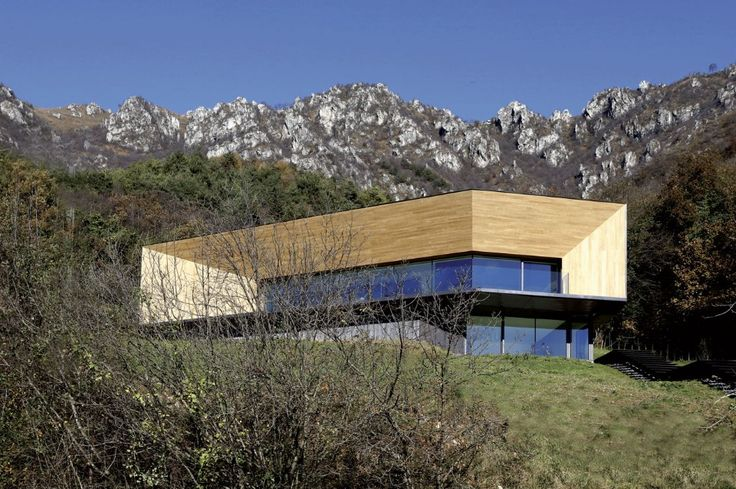 """Located in a clearing close to the """"Passo del Cavallo"""" in Italy, this single family house by CamilloBotticini Architetti relates to the Alpine landscape and fits in the ground."""