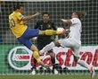 Sweden's Zlatan Ibrahimovic (L) scores a goal past France's Philippe Mexes (R) and goalkeeper Hugo Lloris during their Group D Euro 2012 soccer match at the Olympic stadium in Kiev, June 19, 2012.