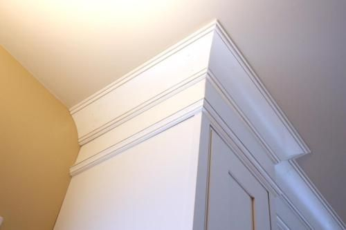 There is no gap between the top of the cabinets and the ceiling for grease and dirt to settle.