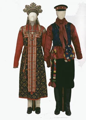 Festive costumes of a young unmarried women and a young unmarried man. Russains. North Russia. Vologda Province. Late 19th cen.
