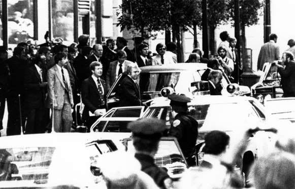 September 22, 1975: PRESIDENT GERALD R. FORD SURVIVES SECOND ASSASSINATION ATTEMPT  Sara Jane Moore attempts to shoot President Gerald R. Ford outside a San Francisco hotel, but misses. (Moore served 32 years in prison before being paroled on December 31, 2007.)