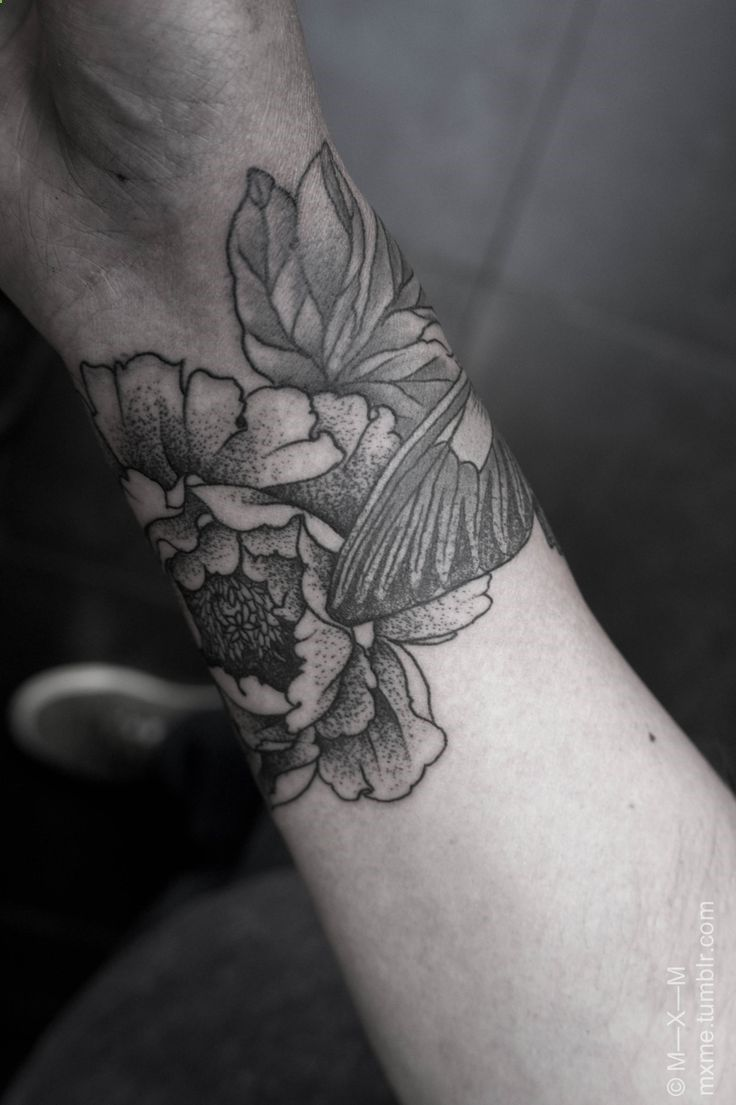 Floral blackwork arm wrap tattoo...still debating whether or not to have mine shaded. Im liking the way this looks though.