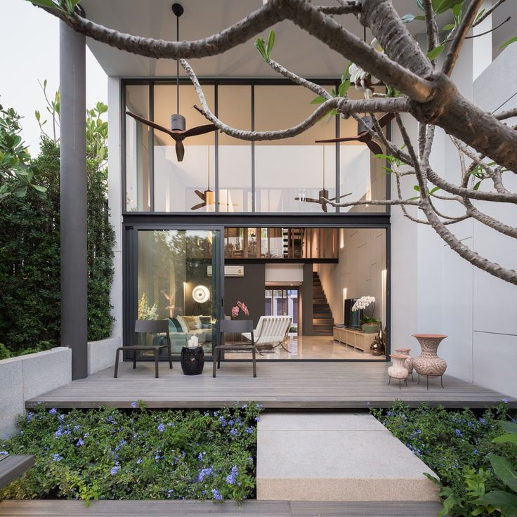 Part of an 18-unit housing development by baan puripuri, this modern townhouse is situated in a lively area of Bangkok, Thailand, complete with a garden.