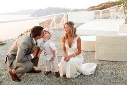 destination_wedding_photography_santorini_child_kissing_dad_sunset