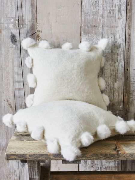 Pom Poms cushions to curl up watching the snowfall outside, snug and warm inside. #HomebaseMumsnetXmas
