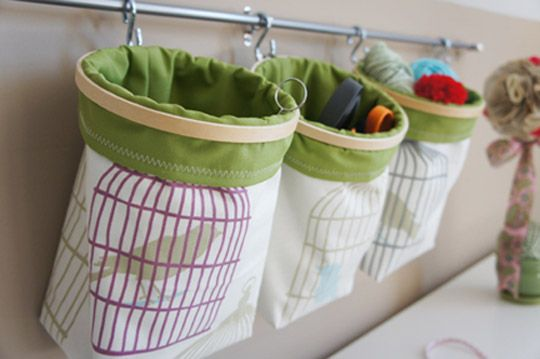 Embroidery hoops give DIY fabric buckets some structure. Hang em on the wall!