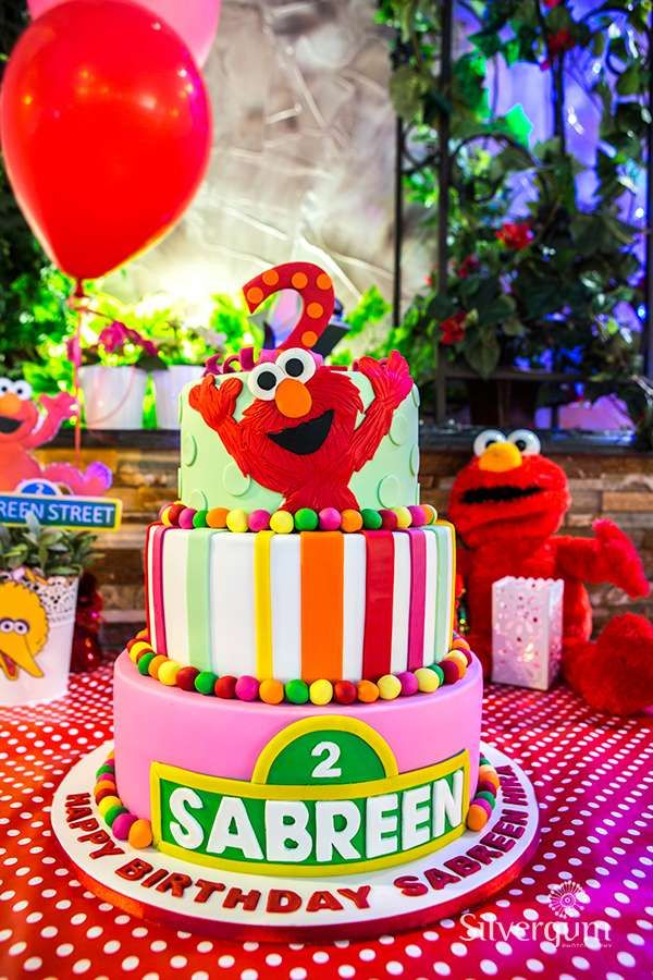 Colorful cake at a Sesame Street Elmo birthday party! See more party ideas at CatchMyParty.com!