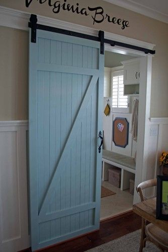 Traditional Home Barn Doors. Good design and proportion for the living room