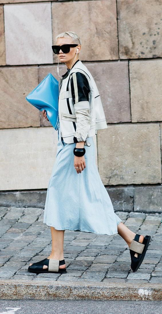 Proenza Schouler sandals, blue dress, and blue clutch with a white and black leather jacket