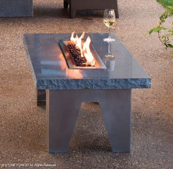 "How cool is this fire table?  Blue/Gray granite slab on stainless steel base (18.4 x 42 x 24"").    (Vesta Fire Table by Stone Forest)"