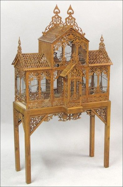 Carved wooden birdcage on stand