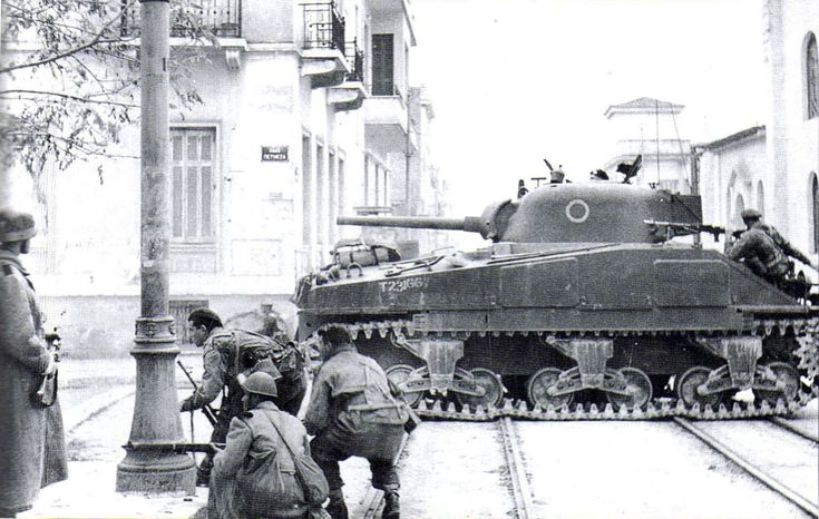 Battle of Athens, Dec 1944: British paras & Greek gendarmes battle communist guerrillas in the middle of Athens with the support of a Sherman tank. *Note the gendarme on the left wearing a German helmet.