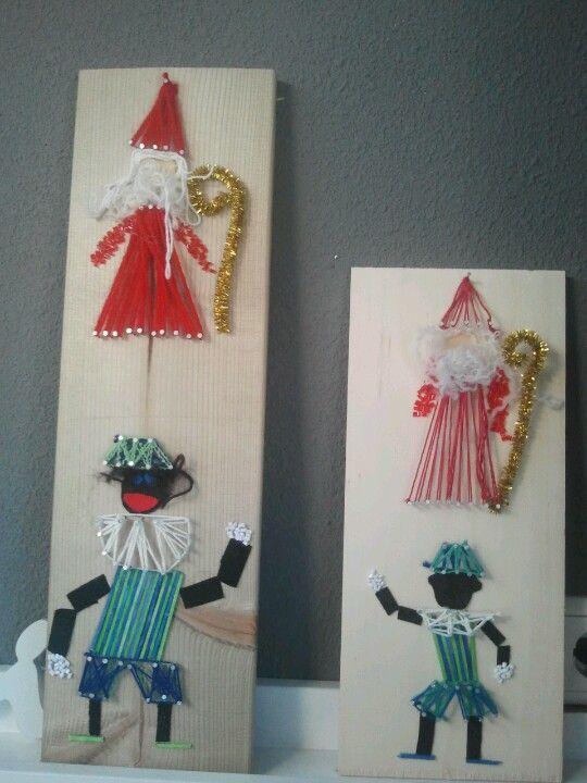 Sinterklaas & zwarte Piet van hout/spijkers/draad/vilt. (opdracht voor groep 5)