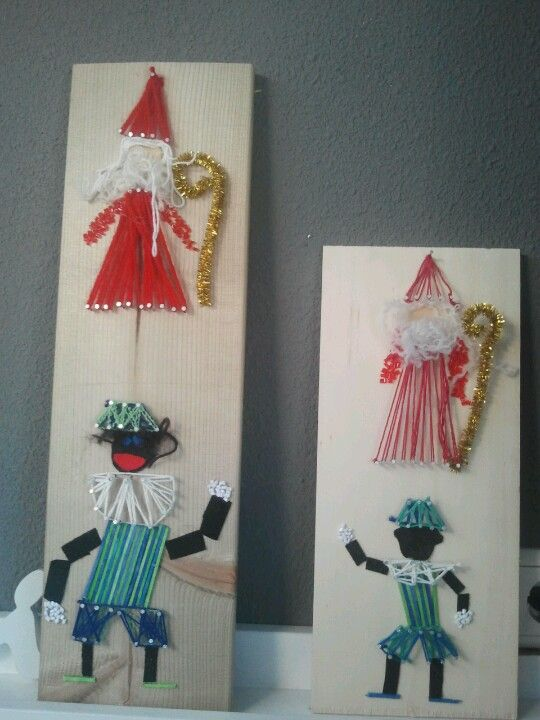 Sinterklaas & zwarte Piet van hout/spijkers/draad/vilt.