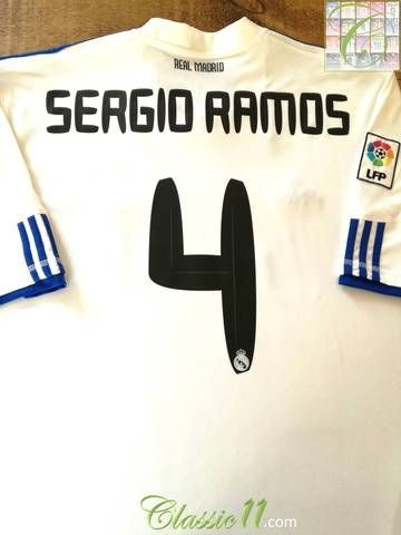 Official Adidas Real Madrid home football shirt from the 2010/2011 season. Complete with Sergio Ramos #4 on the back of the shirt and La Liga patch on the sleeve.
