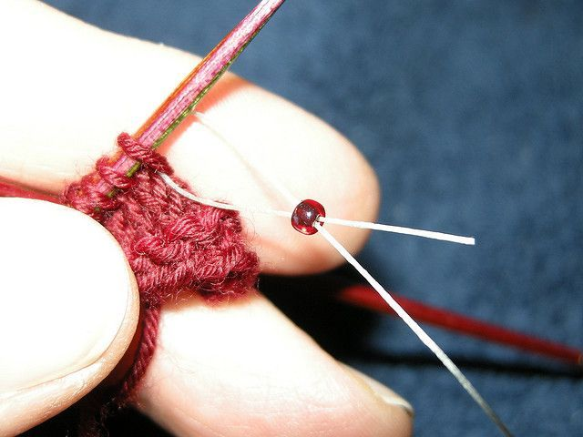 Adding beads to knitting using dental floss: