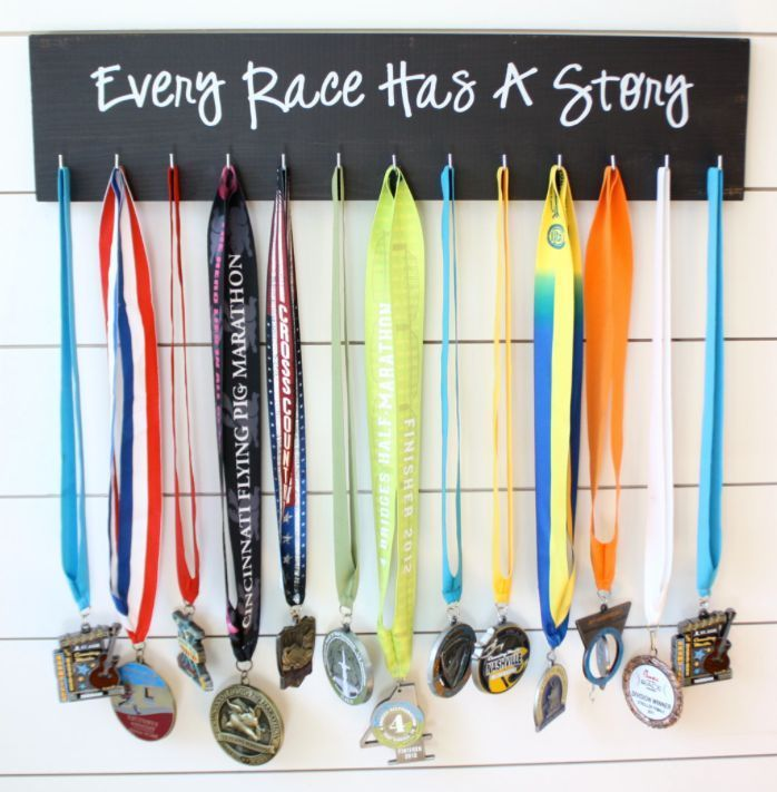 """RUNNING MEDAL DISPLAY """"EVERY RACE HAS A STORY"""" Black w/White Lettering"""