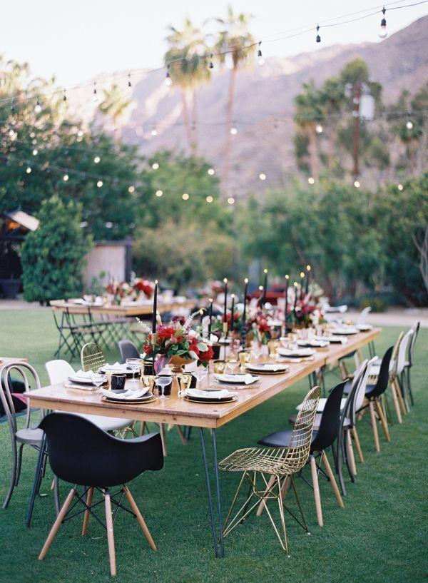Modern black, red and brass wedding decor for an outdoor desert wedding reception   Photography: Ashley Kelemen - http://ashleykelemen.com/