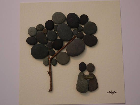 A beautiful and unique handmade pebble art picture of couple sitting under tree. This picture would compliment any room or make a perfect gift. The picture is made using pebbles, wood and thin jewellery wire. All materials are carefully placed and fixed with high strength glue onto high quality white linen card. The picture is in a lovely rustic washed wood frame. The frame is approximately 9x9 inches (23.2xmx23.2cm) and has a lovely rustic washed wood effect. The picture is behind glass and…