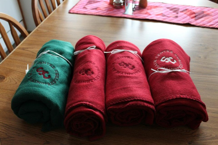 These are extras I have.  I digitized and embroidered our school logo onto some fleece blankets.  Sauk Centre Mainstreeters.  These are for sale.  I made some of these for customers as well.  paulaluberts@pqcomp.com