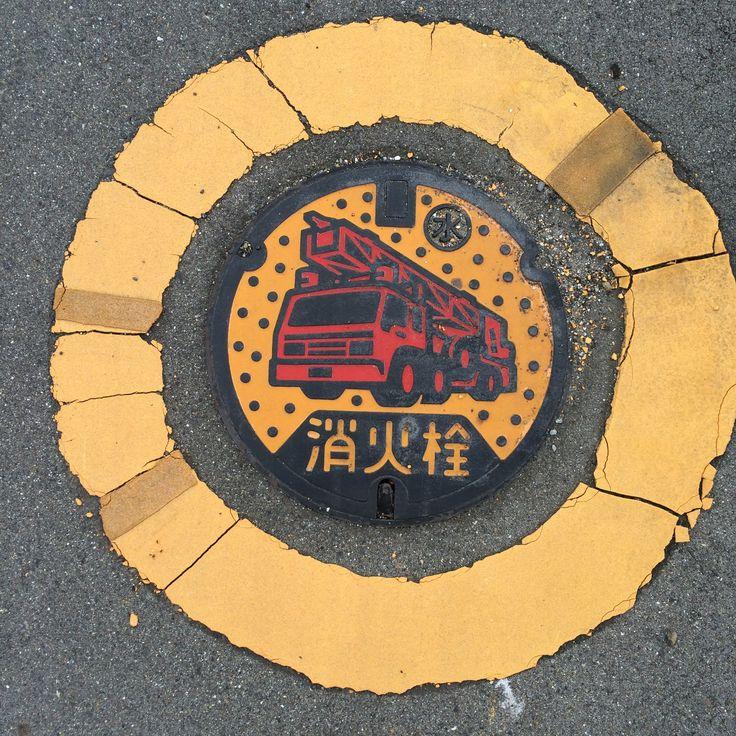Fire hydrant manhole cover. Place: Inazawa city, Aichi, Japan.