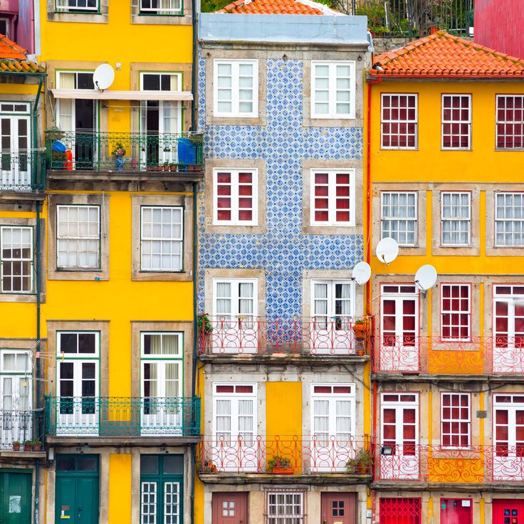 Porto Porto, Portugal building yellow color outdoor Town property house neighbourhood City urban area facade human settlement residential area Architecture condominium tower block home cityscape apartment