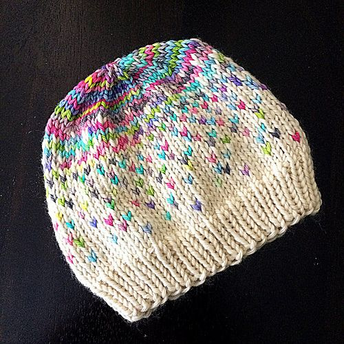 I designed this pattern for a special baby girl named Kaiya Mei. This Fair Isle motif is intended to fade gradually and randomly from the first color to the second. I chose a multi-color yarn with a natural main color to soften the look, but I think two solid and contrasting colors would work great, too. Get creative!