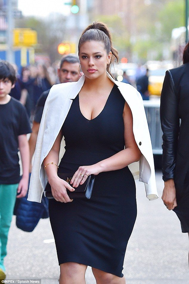 Pretty: The plus-size model upped the glamour in the spring sunshine as she showcased her figure and striking looks
