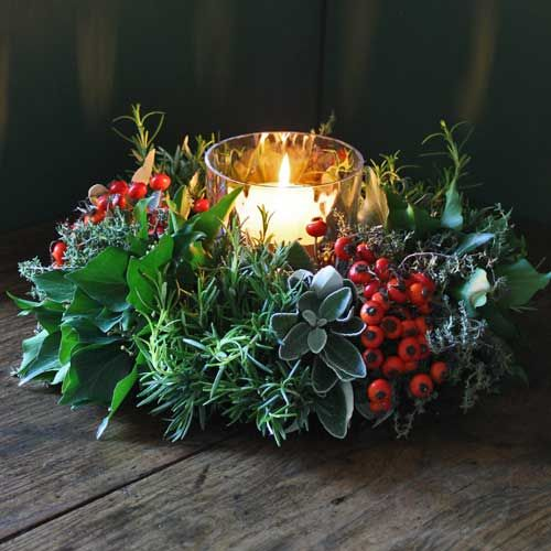 Christmas candle piece made from berried and foliage. This would cost around £15-£20