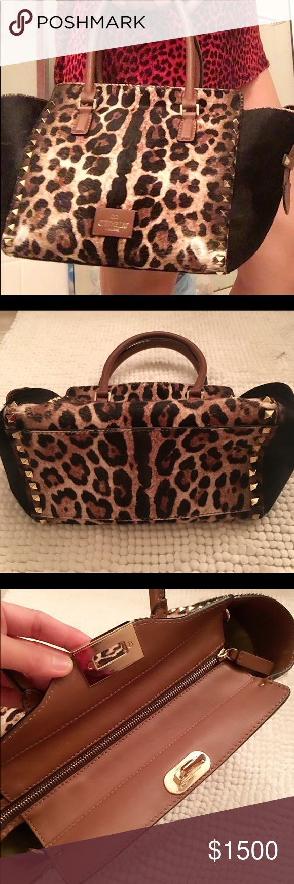 💯auth. VALENTINO ROCK STUD in Leopard pony hair Limited edition and sold out Valentino rockstud. Re listing bag. Still available for sale or trade. Check other listing of this for additional details and info. Inside bag is immaculately clean, no smell, pet and smoke free. Minor bald spotting, check pics. and this doesn't affect the look of the bag. Authenticity guaranteed as shown, attached inside the bag. This bag was Pre owned. No strap when I received it. It's gorgeous and still an IT…