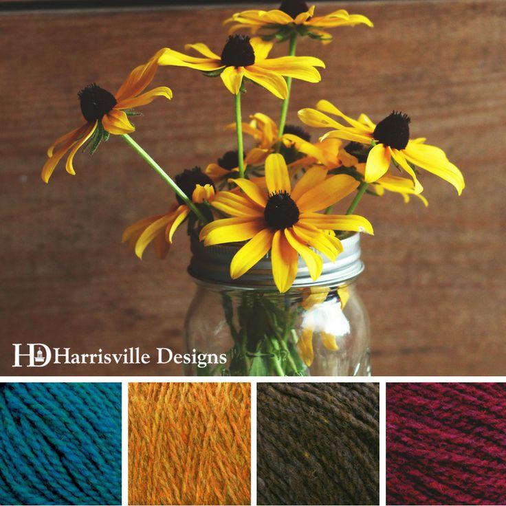 'Blackeyed Susan's' color palette features Shetland yarn in Peacock, Foliage, Walnut, and Garnet Yarn.