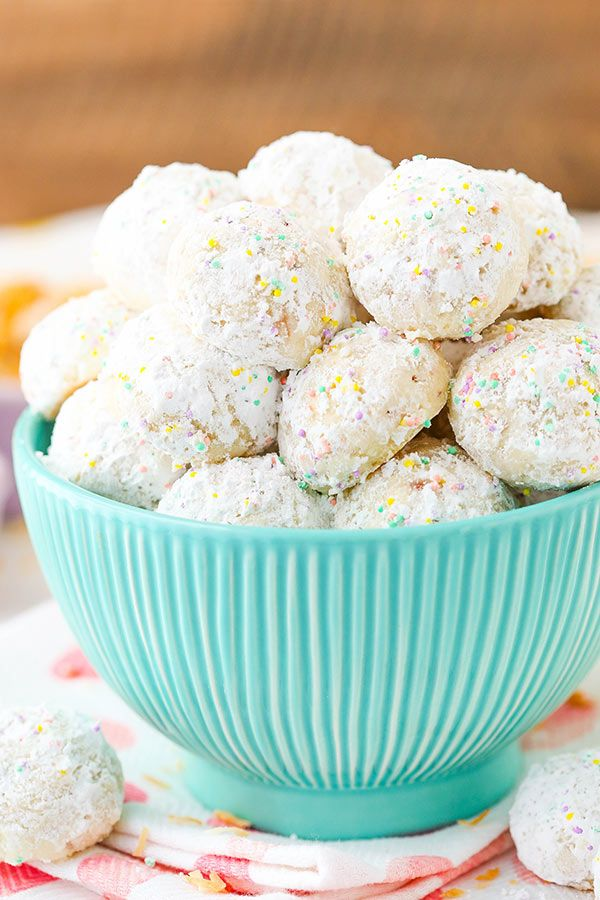 """These Toasted Coconut Bunny Tails are super fun, easy to make and delicious! You may also know them as """"snowballs"""" – cookies that you may make for Christmas. Well, now they are bunny tails with cute pastel sprinkles and they are perfect for Easter! While there were no bunnies harmed in the making of these …"""